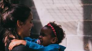 3 Ways to Support Programs of Foster Care Centers Featured Image Woman carrying child on a sunny day 300x168 - 3 Ways to Support Programs of Foster Care Centers