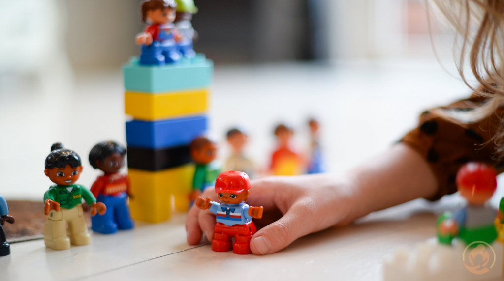 Finding the Best Childcare Center for Adopted Children Featuredimage person playing mini fig 1024x572 - Finding the Best Childcare Center for Adopted Children