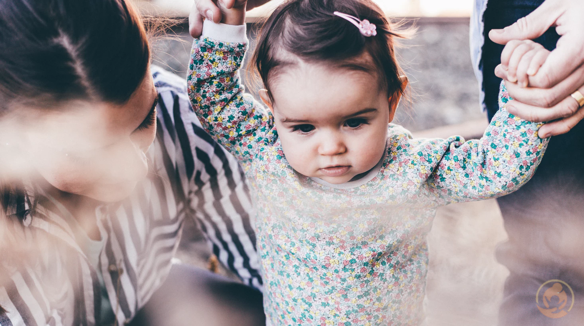 Child Welfare Tips What Childcare Providers and Parents Should Know Feauted Image woman holding girl while learning to walk taken at daytime - Child Welfare Tips: What Childcare Providers and Parents Should Know