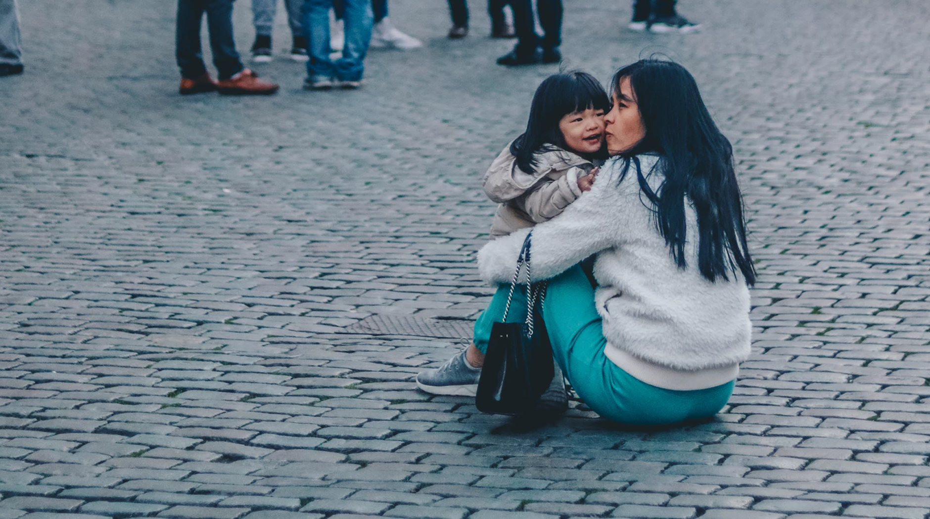 Do you need help Post Image woman kissing girl while sitting near building - Child Welfare Tips: What Childcare Providers and Parents Should Know
